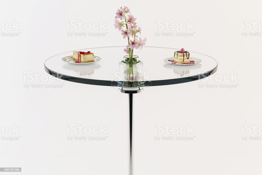 Glass table with Cake and Pink Flowers stock photo