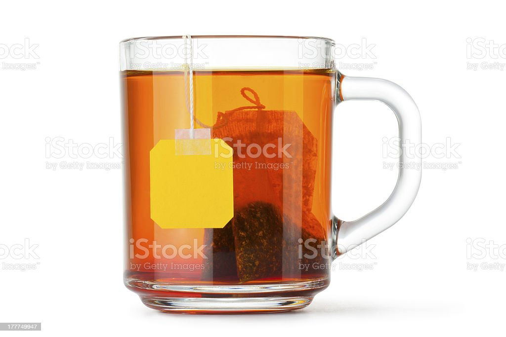 Glass teacup with teabag stock photo