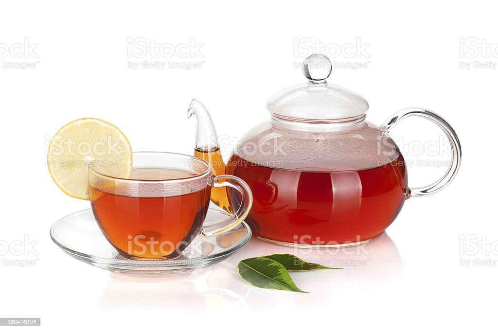 Glass teapot and cup of black tea with lemon slice royalty-free stock photo
