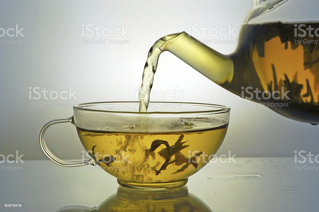 Glass teapot and tea cup royalty-free stock photo