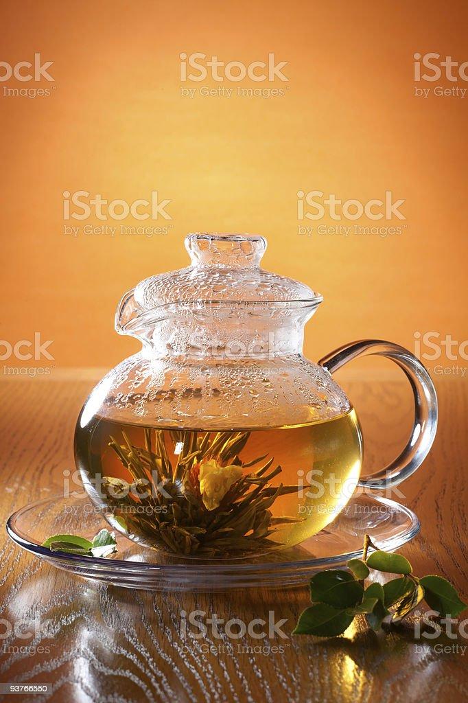Glass teapot with greean tea royalty-free stock photo