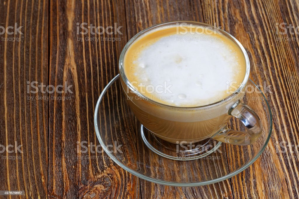 Glass transparent cup with cappuccino stock photo