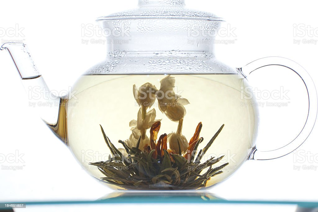 Glass transparent teapot with Flower Chinese blooming tea royalty-free stock photo