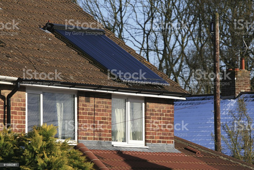 Glass tube solar water heating panel working in the winter royalty-free stock photo