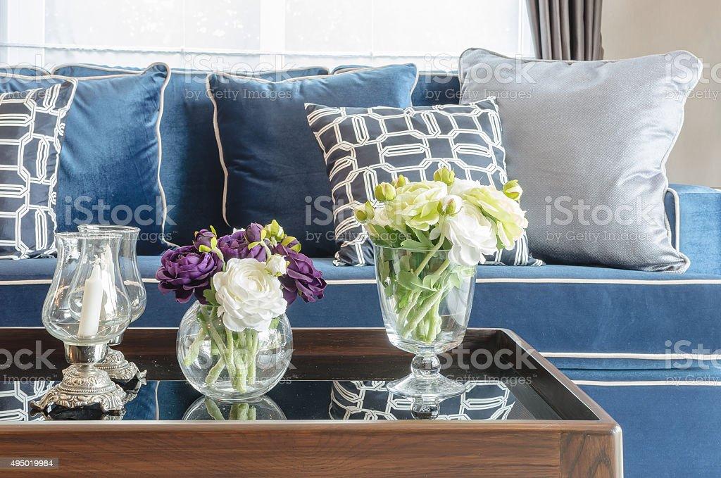 glass vase of flower on table in living room stock photo
