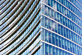 Glass wall of skyscraper, abstract background with copy space