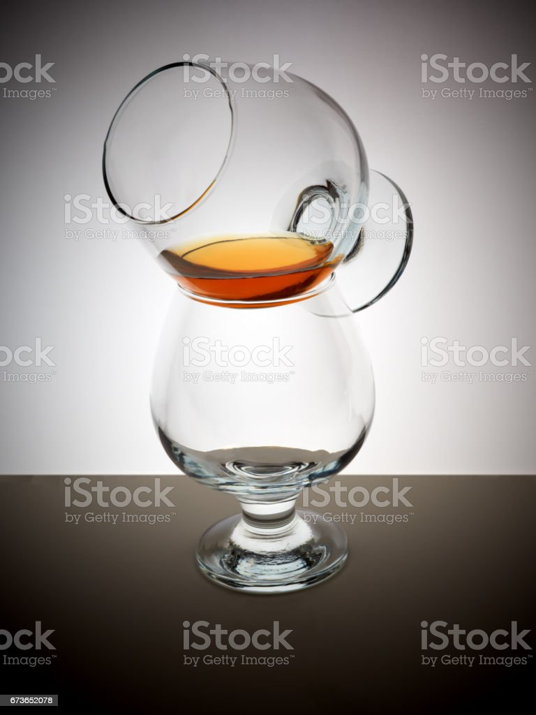 Glass whisky brandy cognac rum background light gradient luster stock photo