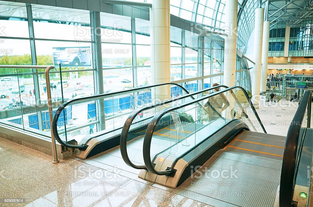 Glass window floor escalator people in modern office building stock photo