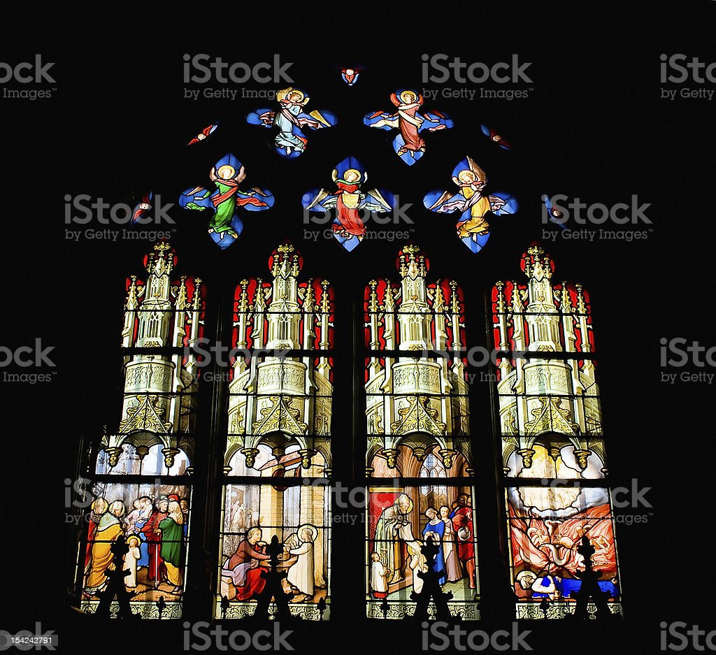 Glass window of Saint Etienne church in Paris royalty-free stock photo