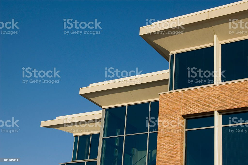 Glass window panel viewed from outside showing blue sky stock photo