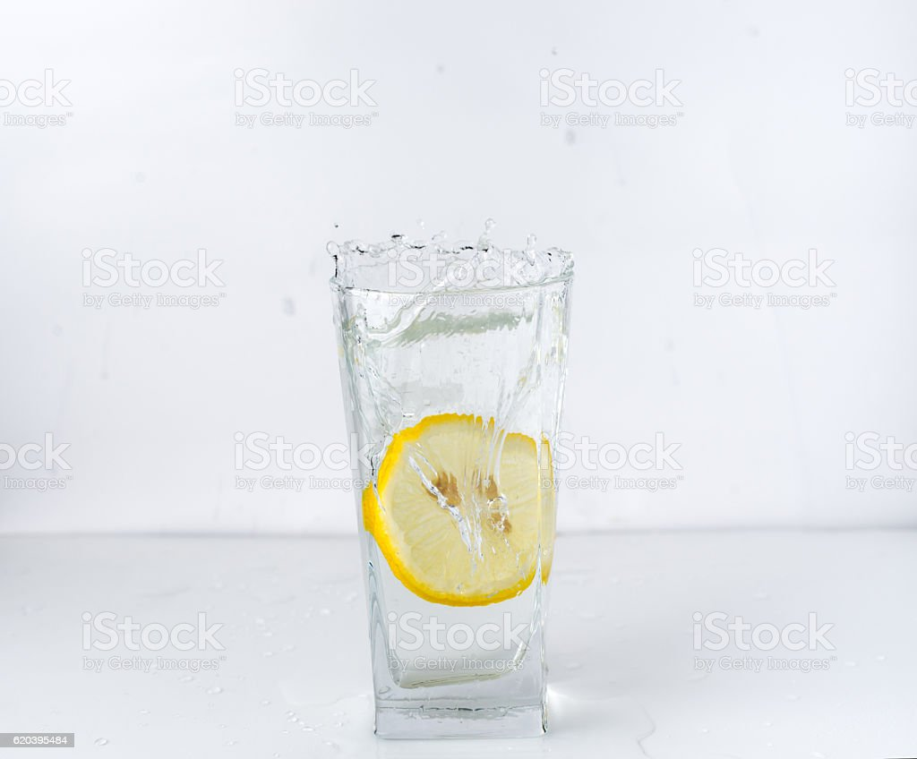 glass with a lemon stock photo