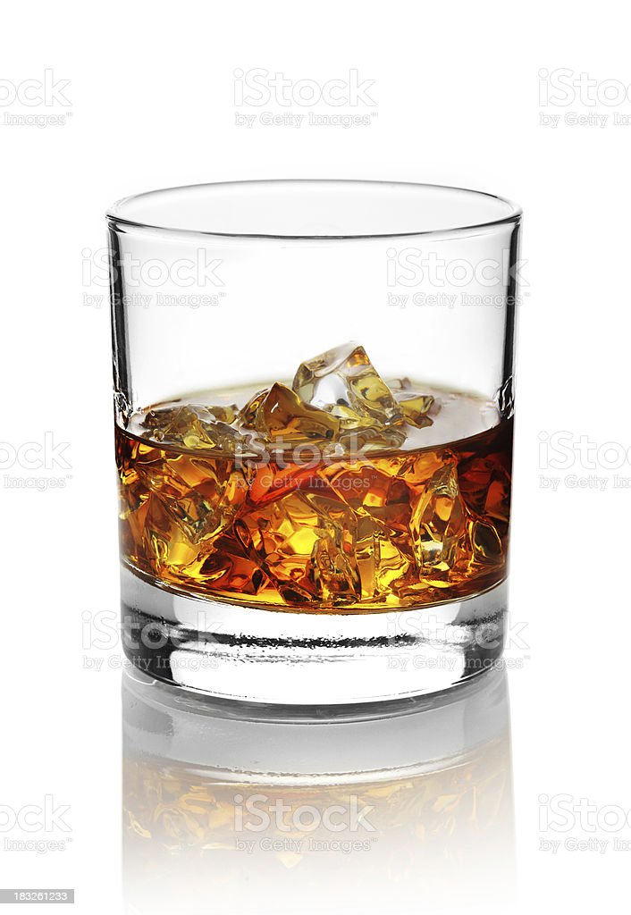 Glass with alcohol and ice cubes. stock photo