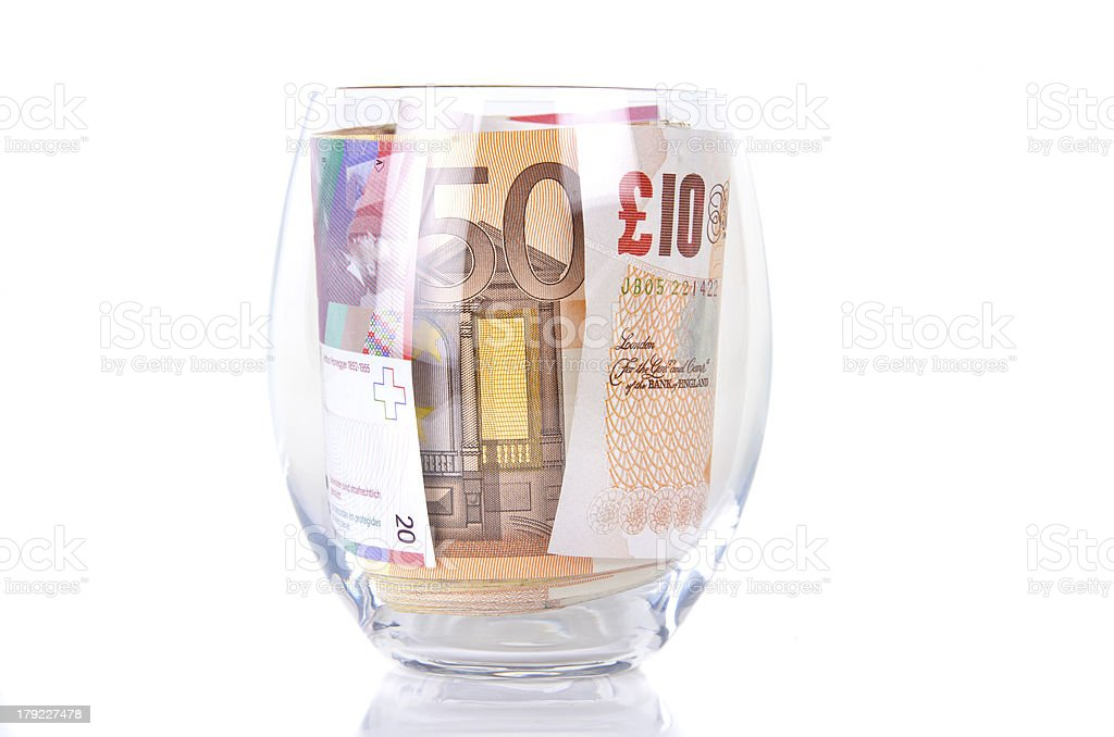 Glass with banknotes royalty-free stock photo