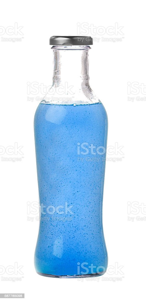 glass with blue cocktail stock photo