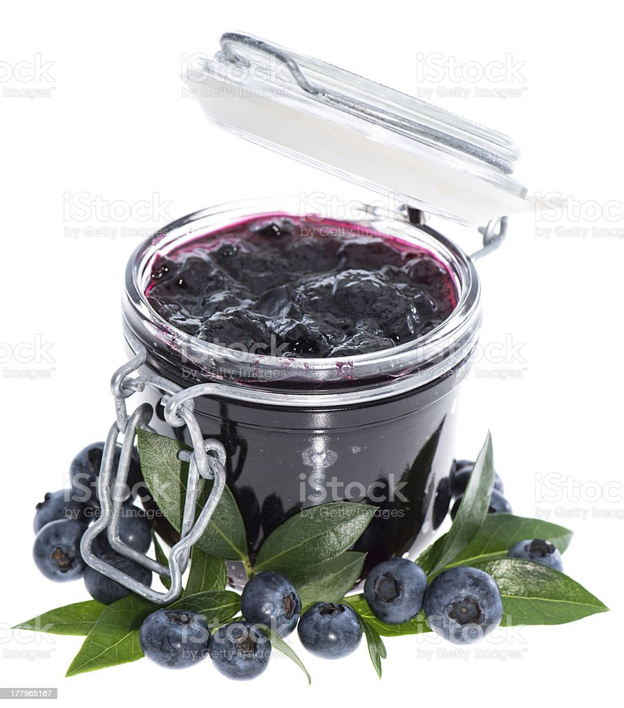 Glass with Blueberry Jam on white royalty-free stock photo