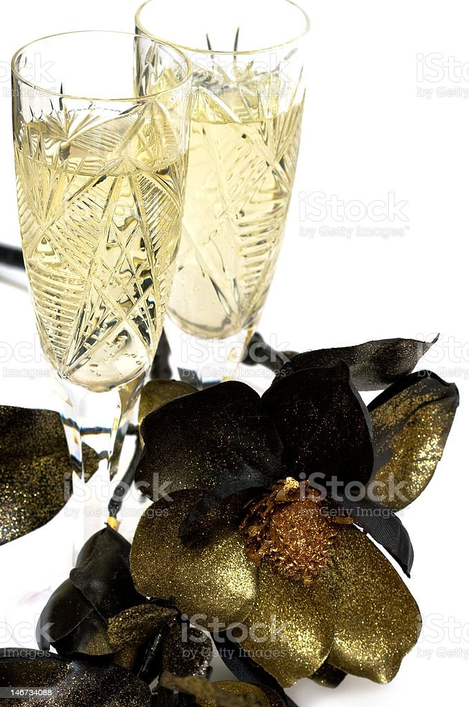 glass with champagne and golden flower royalty-free stock photo