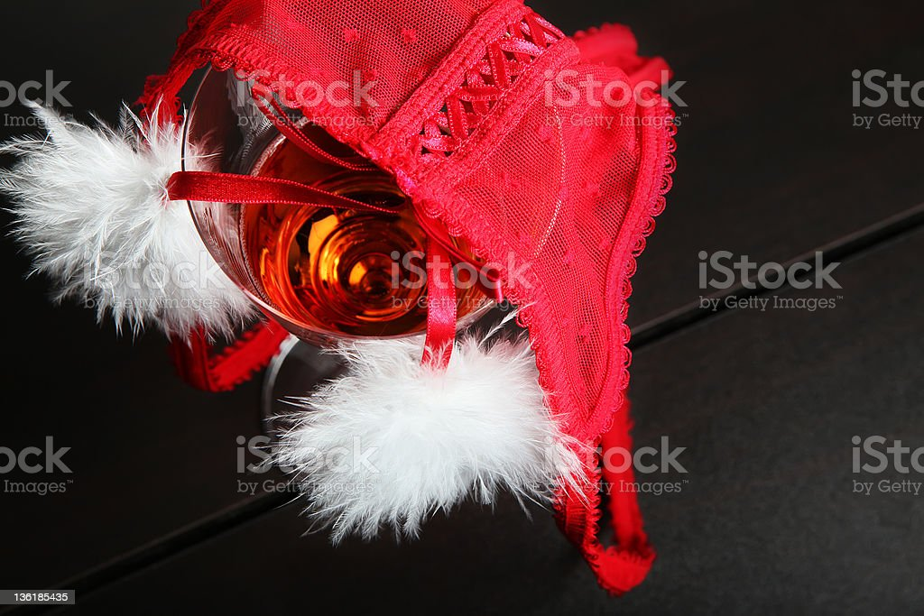 Glass with champagne and red underwear royalty-free stock photo
