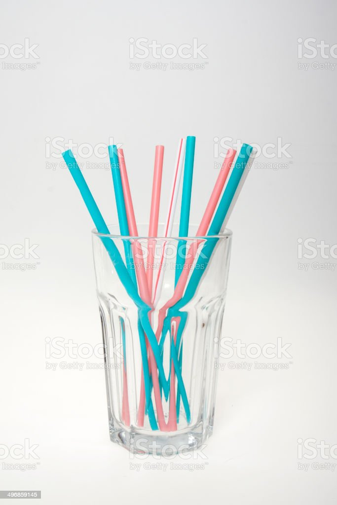Glass with color straws stock photo