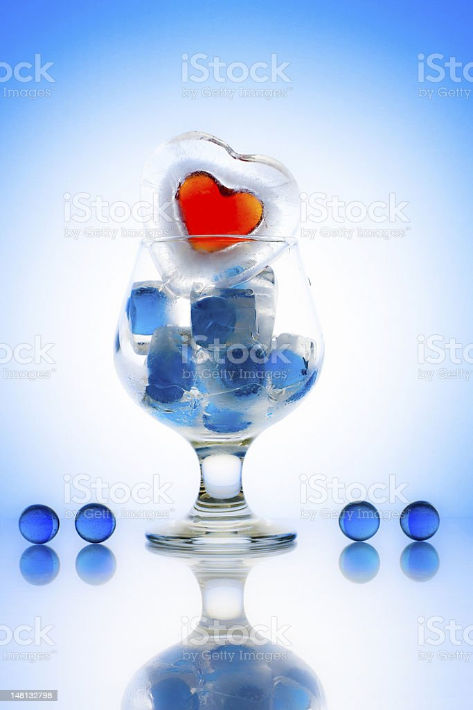Glass with frozen heart shape royalty-free stock photo