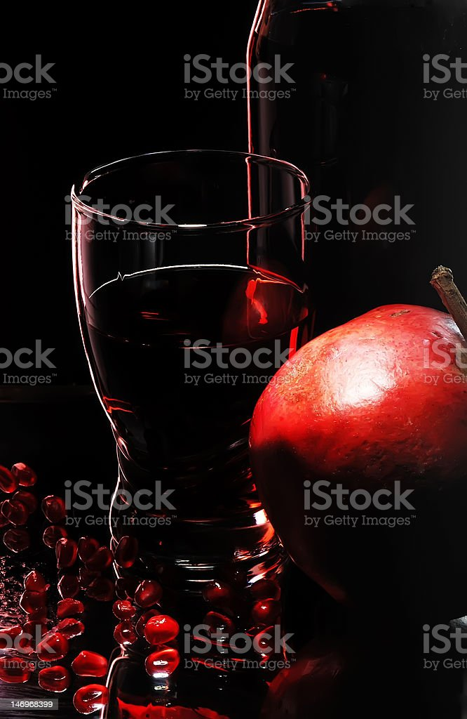 Glass with garnet juice royalty-free stock photo