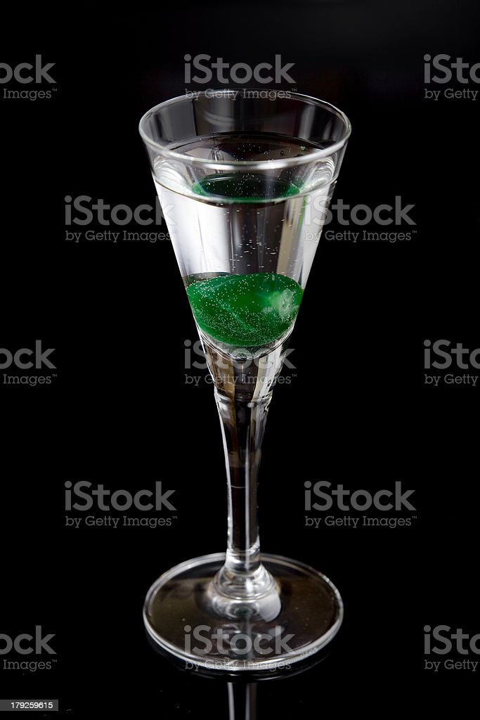 glass with green cherry royalty-free stock photo