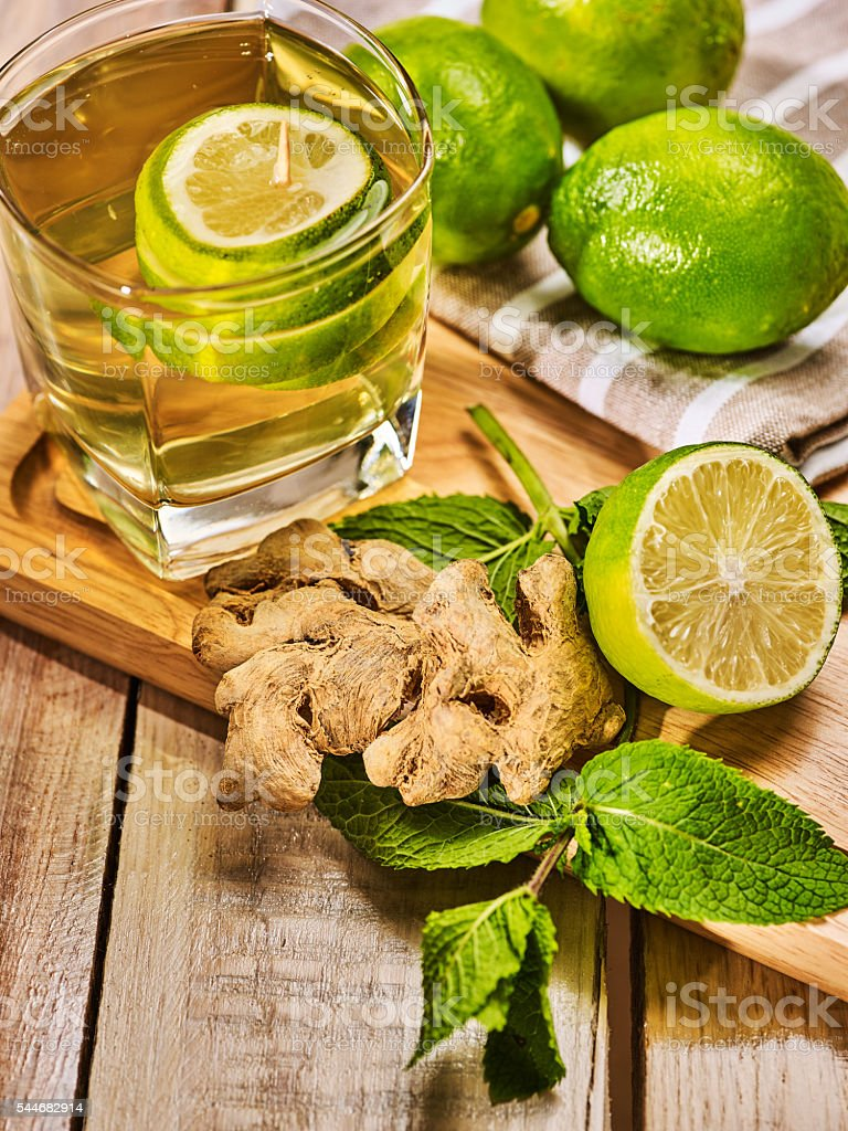 Glass with green Healthy lime drink and ginger . stock photo