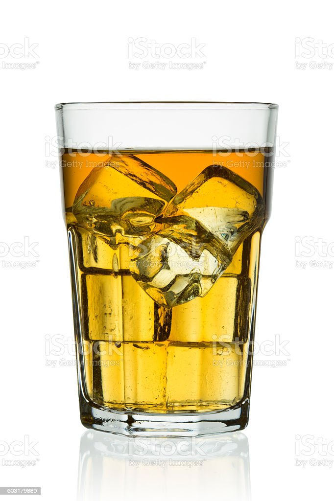 Glass with ice cube and ice tea stock photo