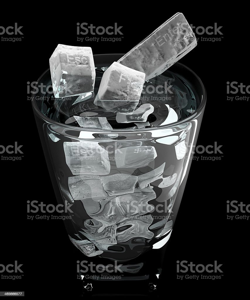 Glass with ice key board cubes. Isolated on Black royalty-free stock photo