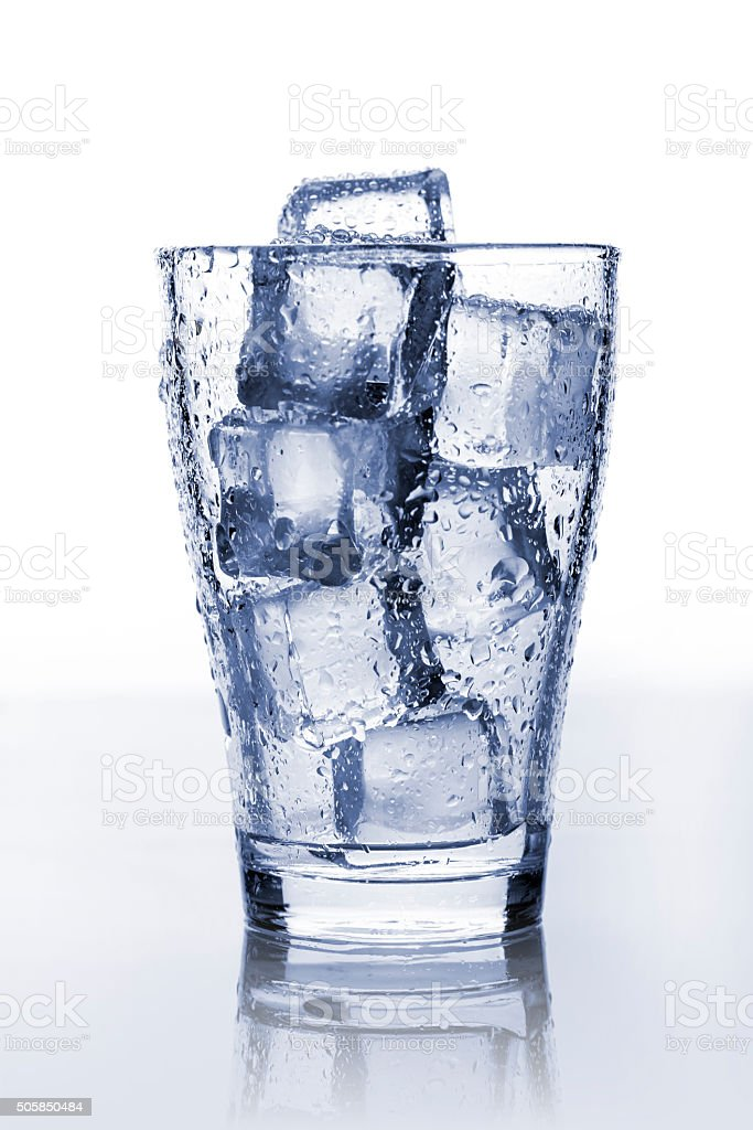 Glass with ice stock photo