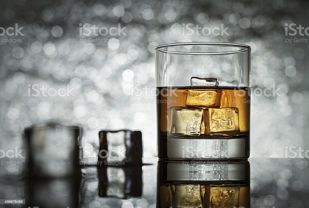 Glass with icecubes on abstract background stock photo