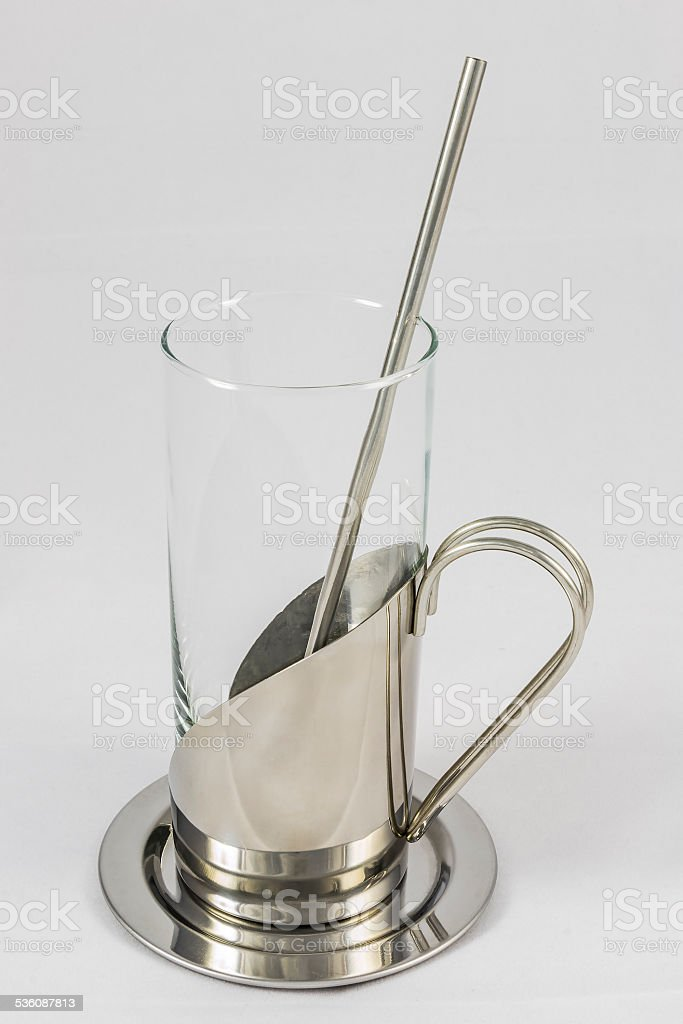 Glass with metallic glass-holder and spoon stock photo