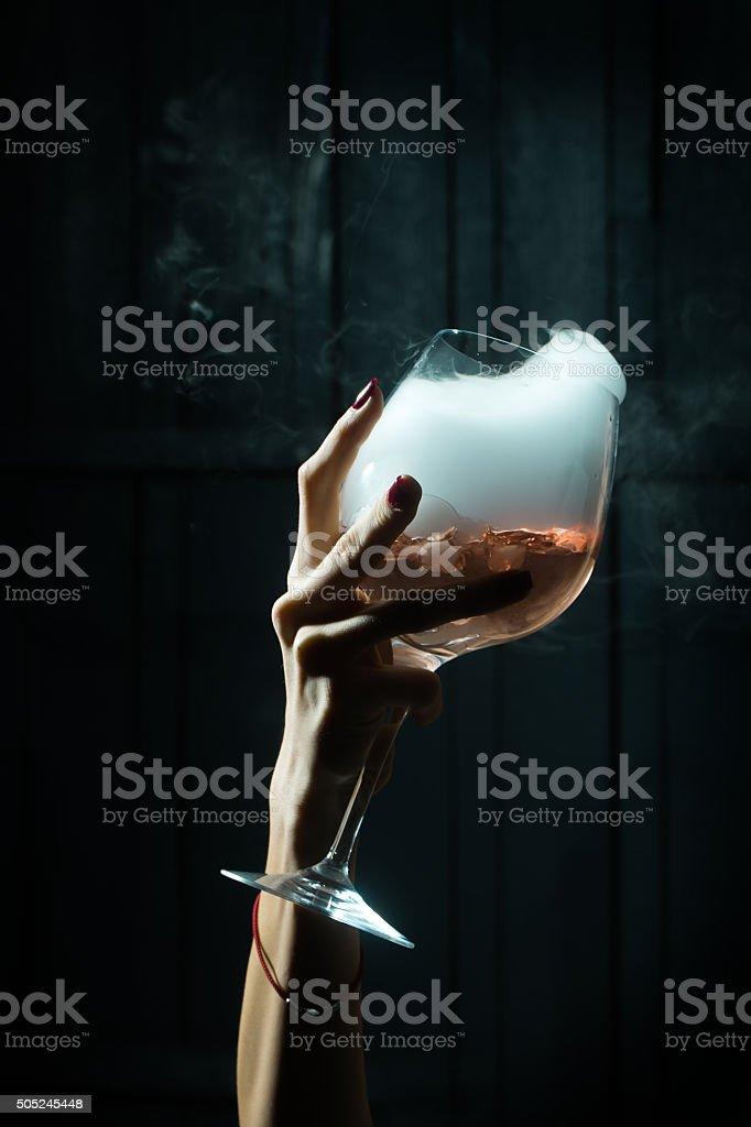 Glass with organic liquid stock photo
