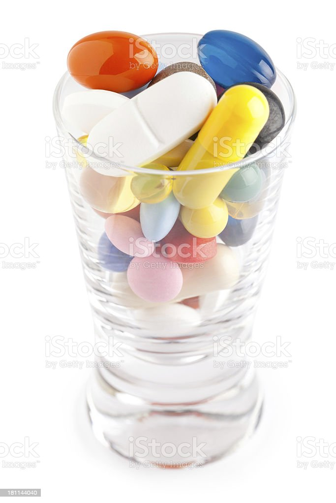Glass with pills royalty-free stock photo
