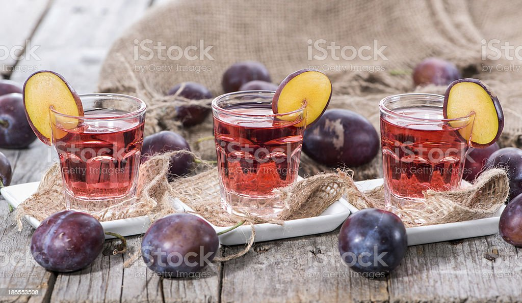Glass with Plum Liqueur royalty-free stock photo