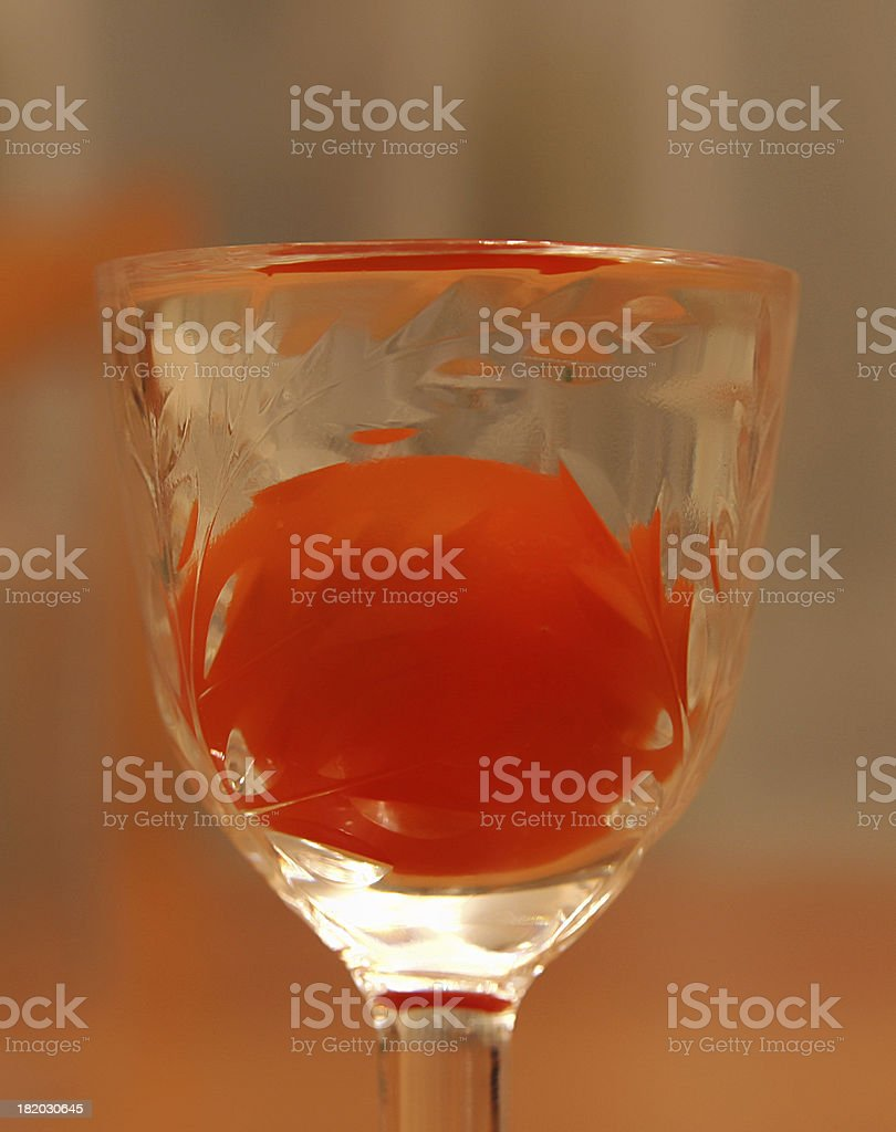 Glass with red tomato royalty-free stock photo