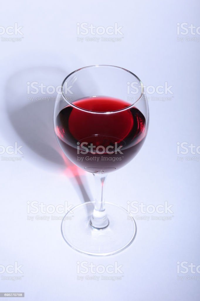 Glass with red wine grapes isolated on white background. stock photo