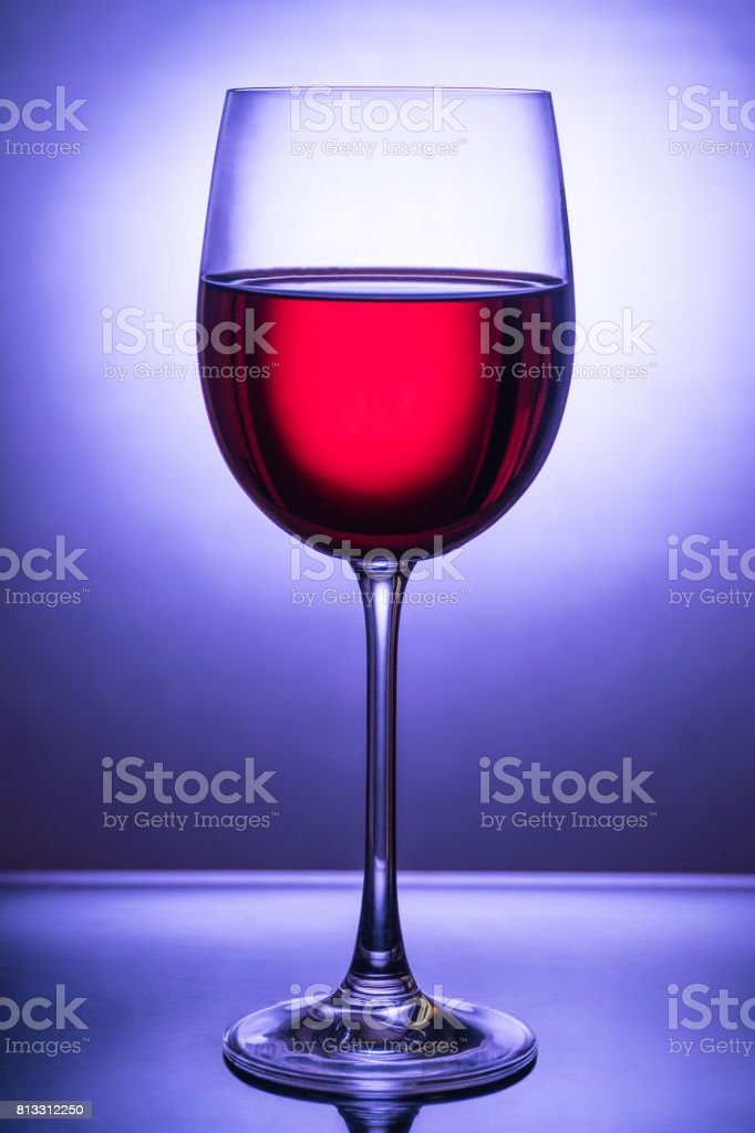 Glass with red wine opposite the light stock photo