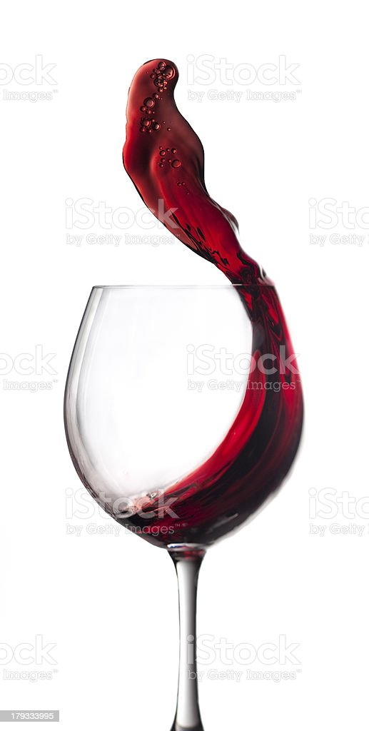 Glass with red wine splash royalty-free stock photo