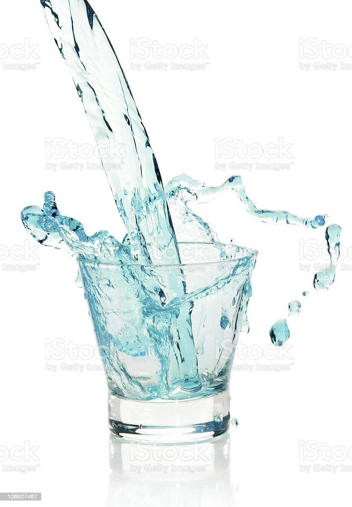 Glass with splashing blue drink royalty-free stock photo