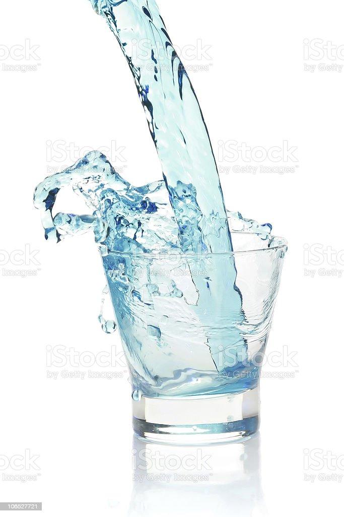 Glass with splashing blue drink. royalty-free stock photo