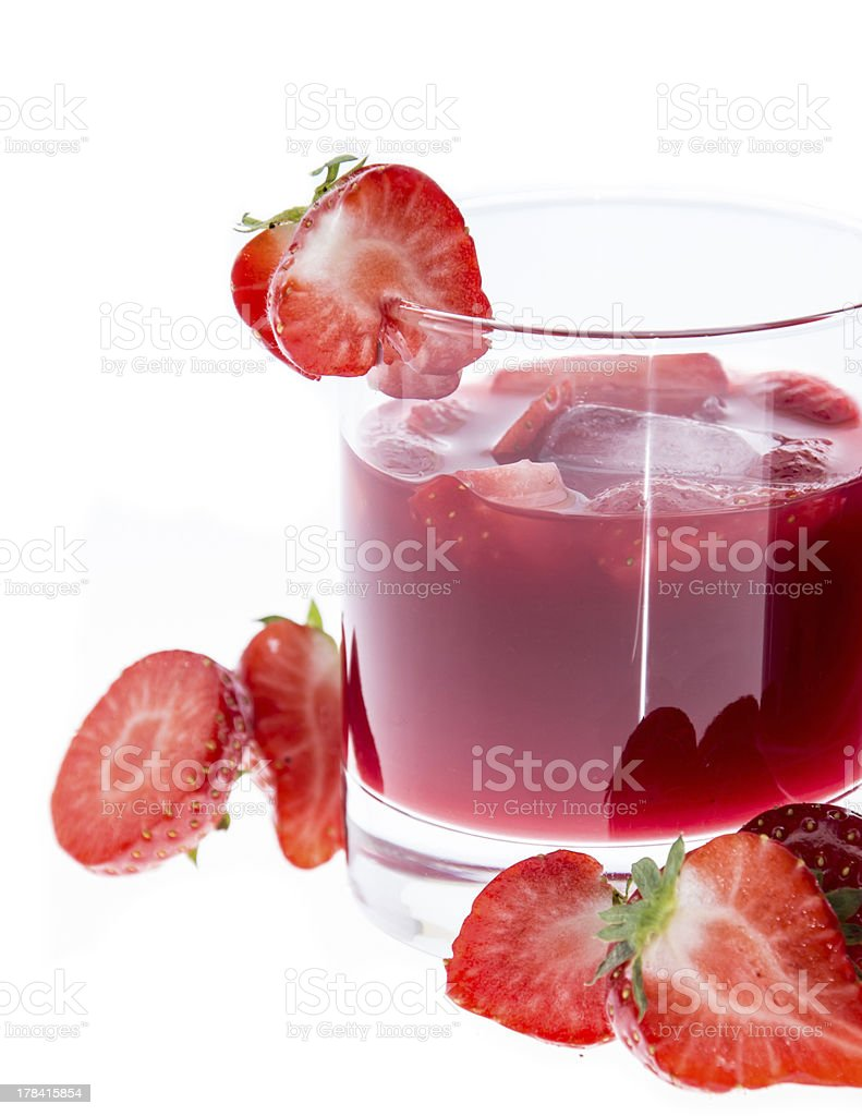 Glass with Strawberry Liqueur on white stock photo