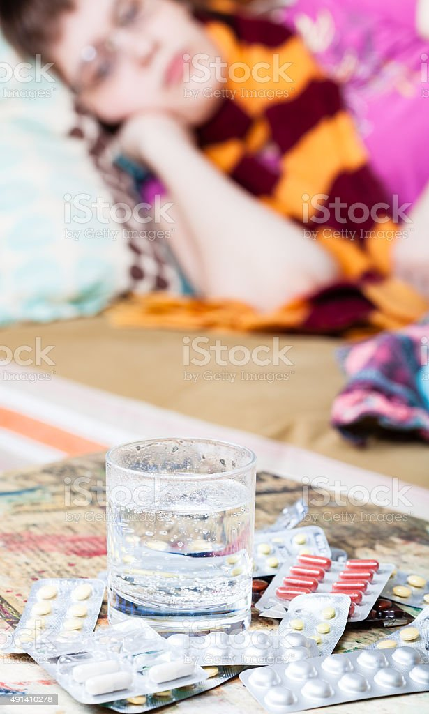 glass with water and medicaments on table stock photo