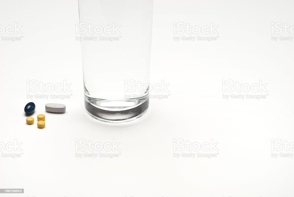 Glass with water and medicine. royalty-free stock photo