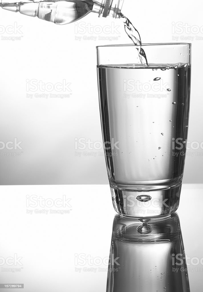 Glass with Water Bottle royalty-free stock photo