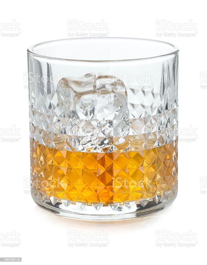 Glass with whiskey and ice cubes stock photo