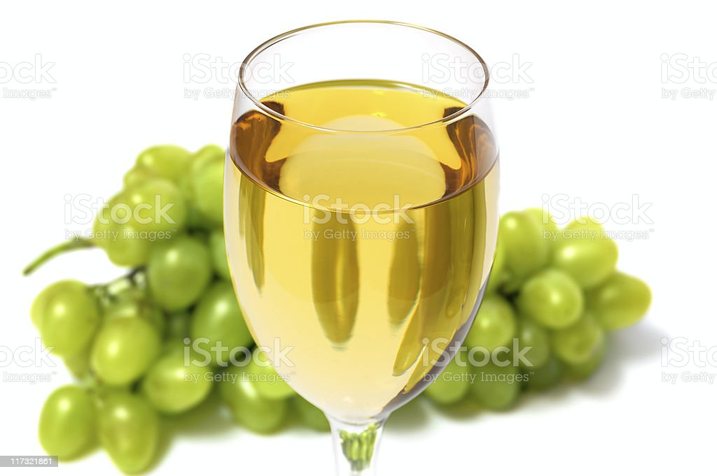 Glass with wine and grape cluster royalty-free stock photo