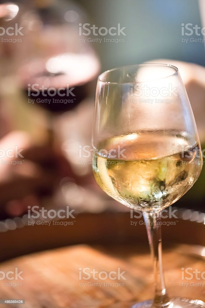 Glass with wine on the table stock photo