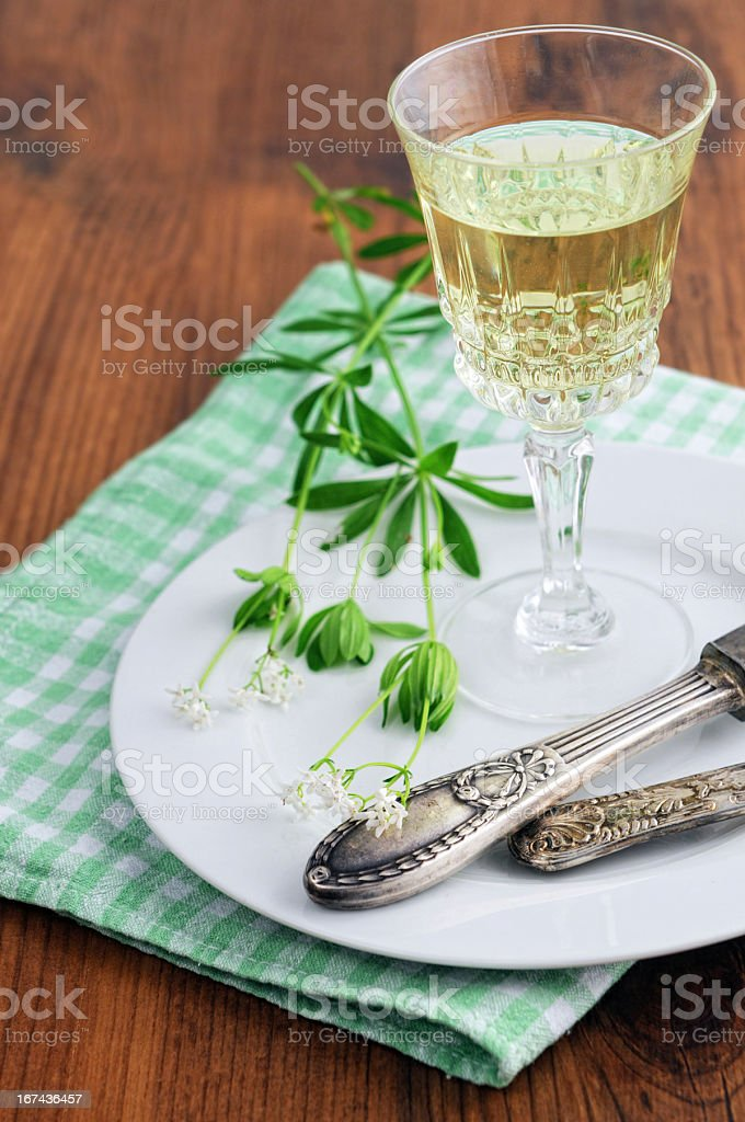 glass with woodruff punch on a platte stock photo