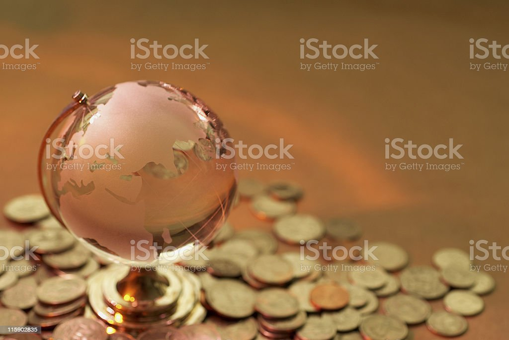 Glass World and coin royalty-free stock photo