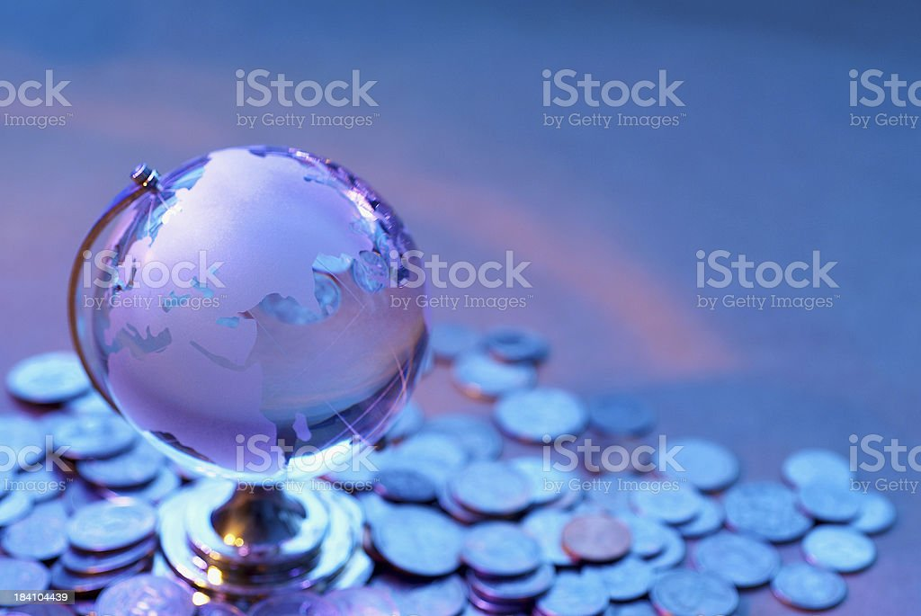 Glass World and coin stock photo